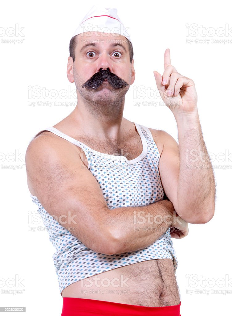 cook in undershirt pointing the finger up stock photo