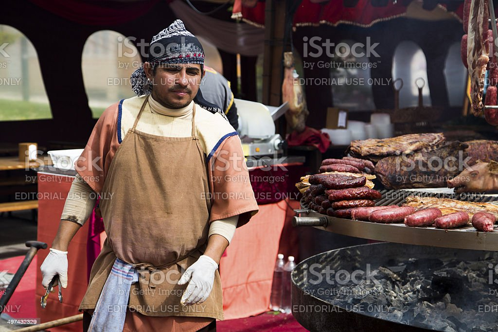 Cook man in medieval market stock photo