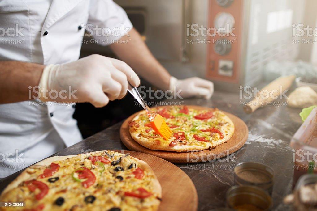 Cook misses edge freshly prepared pizzas stock photo