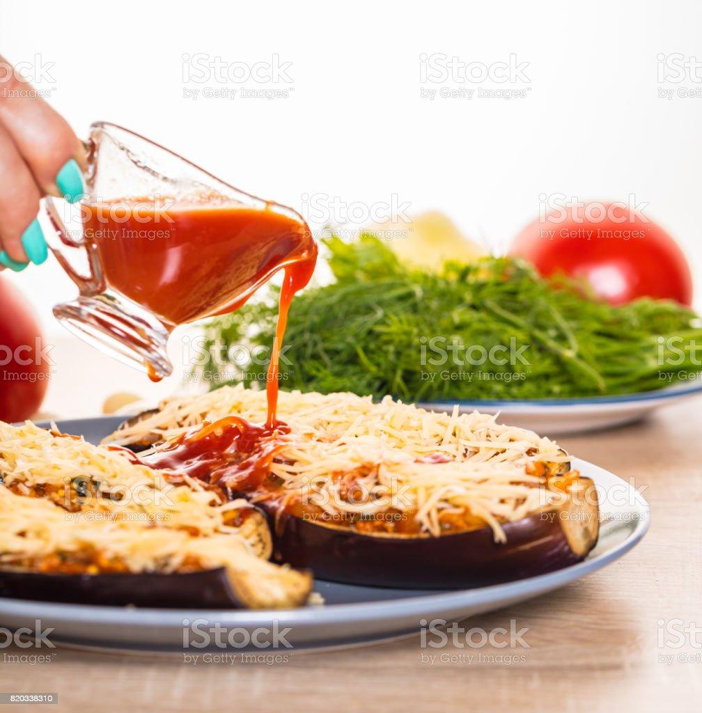 Cook pours tomato sauce stock photo