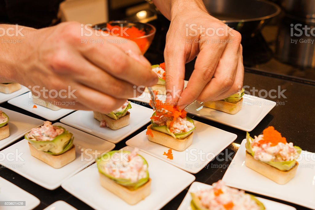 cook prepared delicious gourmet canapé starters stock photo