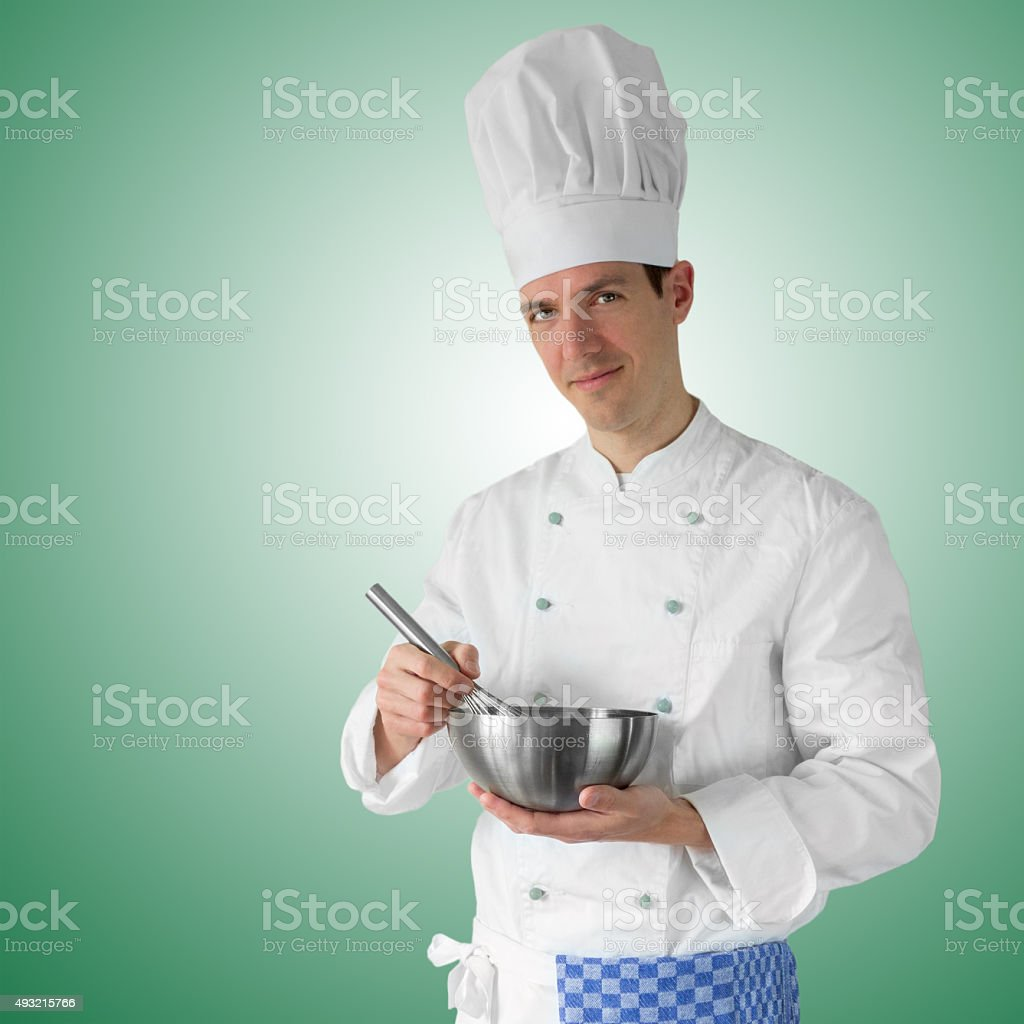 Cook preparing some food for dinner stock photo