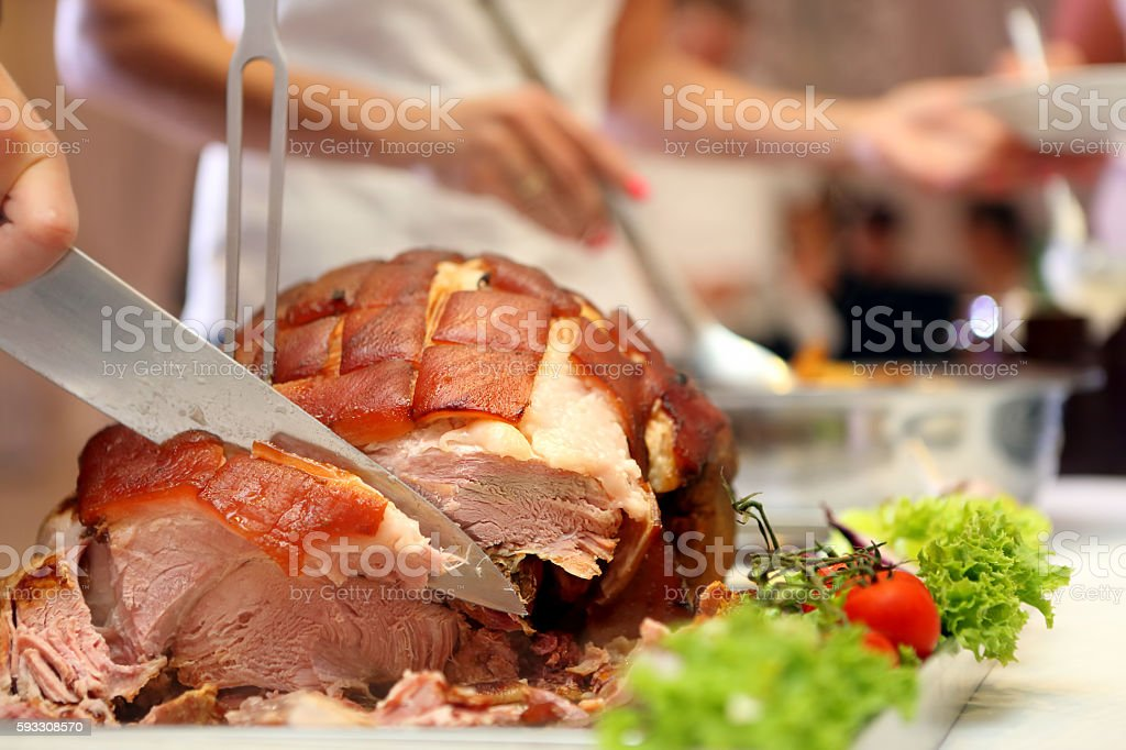 Cook sliced roasted meat at the party stock photo