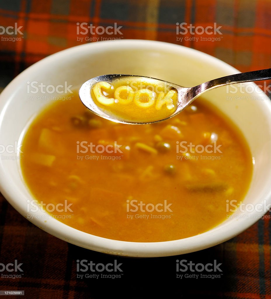 Cook spelled out on a soup spoon stock photo
