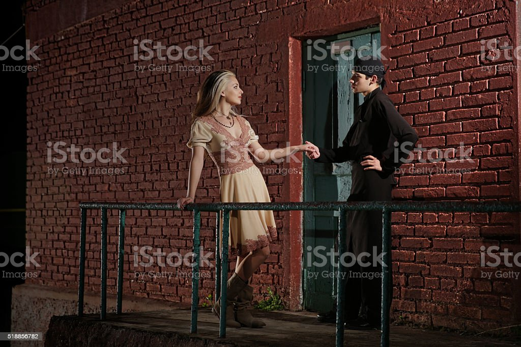 Cook standing near kitchen backdoor with a girl stock photo