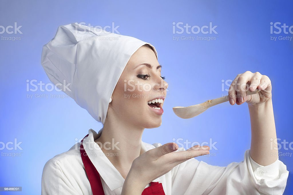 Cook tasting using wood spoon royalty-free stock photo