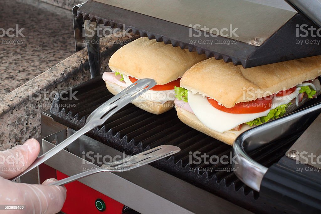 Cook tasty toasted sandwiches stock photo