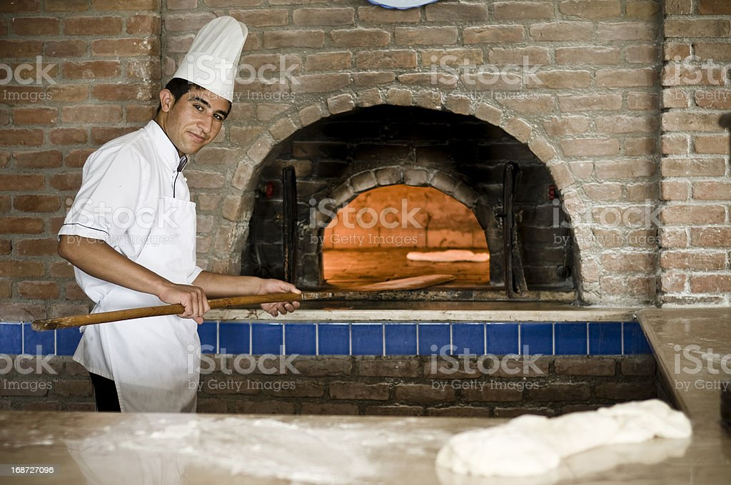 cook with pizza stock photo