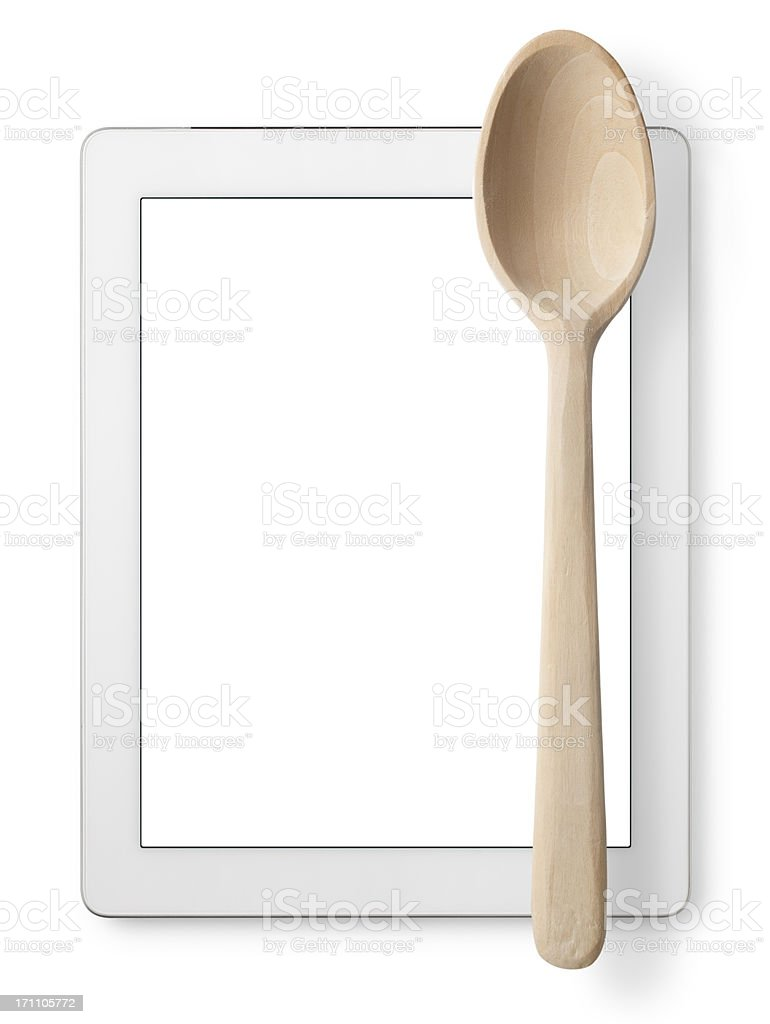 Cookbook. Tablet with wooden spoon. stock photo