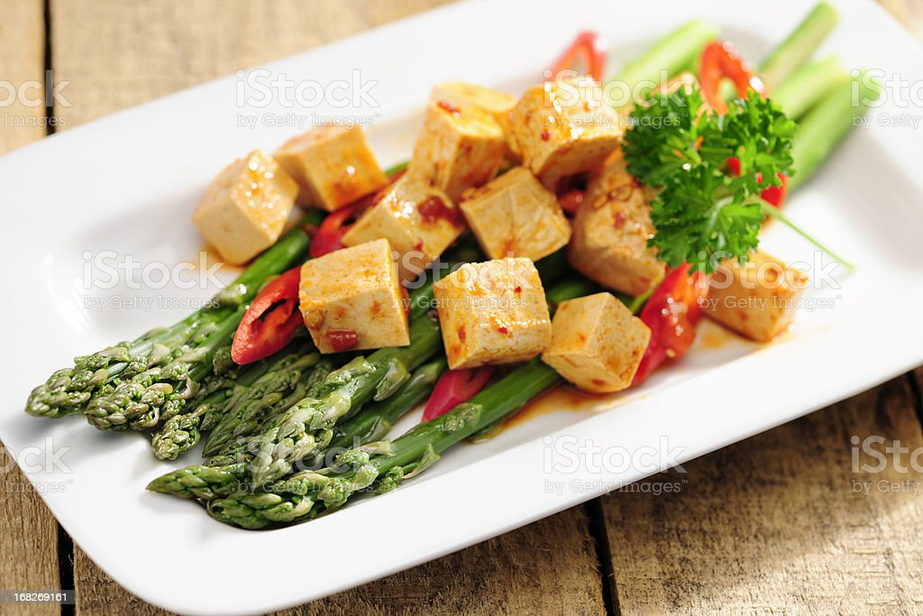 Cooked Asparagus and marinated Tofu stock photo