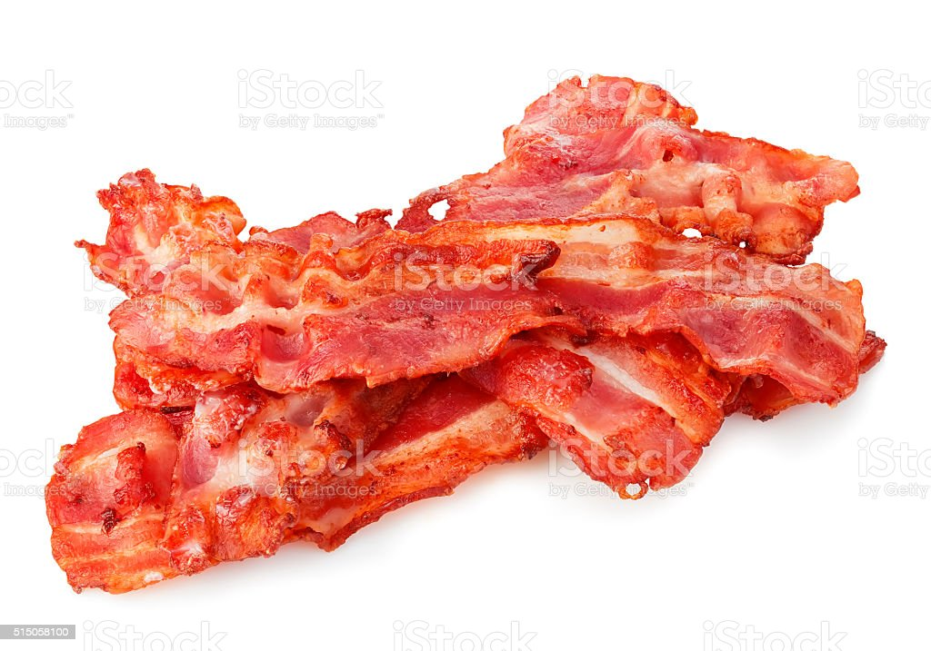 Cooked bacon rashers close-up isolated on a white background. stock photo