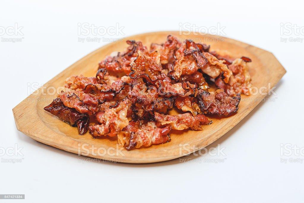 Cooked bacon rashers isolated on white stock photo