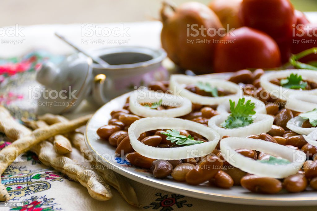 Cooked beans with onions and herbs stock photo