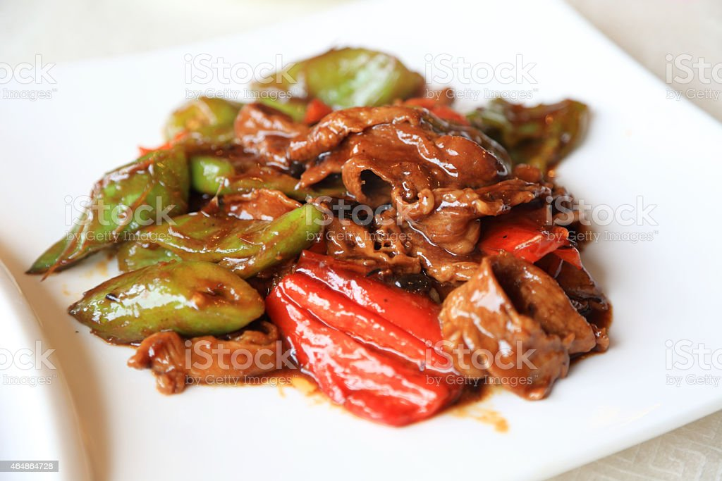Cooked beef  and vegetables on a white plate stock photo