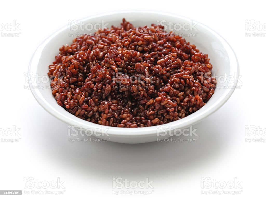 cooked bhutanese red rice isolated on white background stock photo