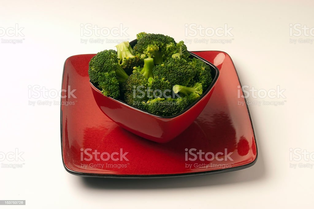 Cooked Broccoli in red bowl stock photo