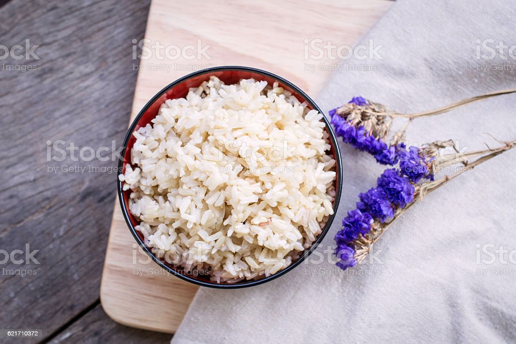 Cooked brown rice in a bowl stock photo