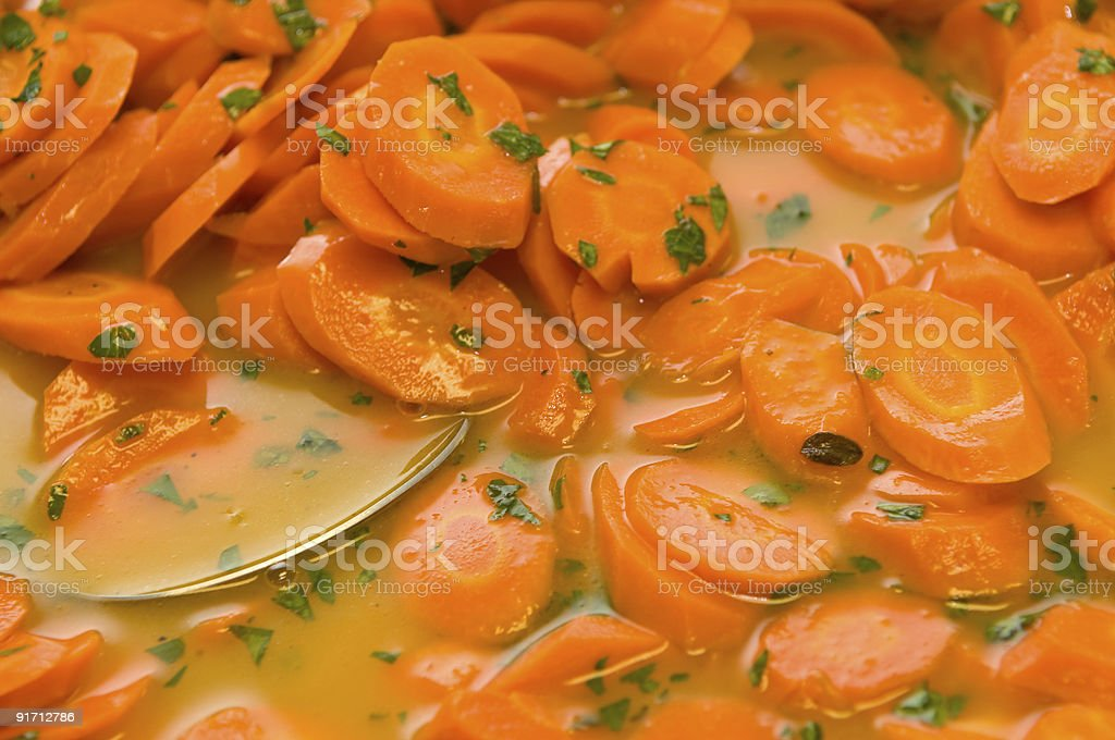 Cooked carrots in reduction. royalty-free stock photo