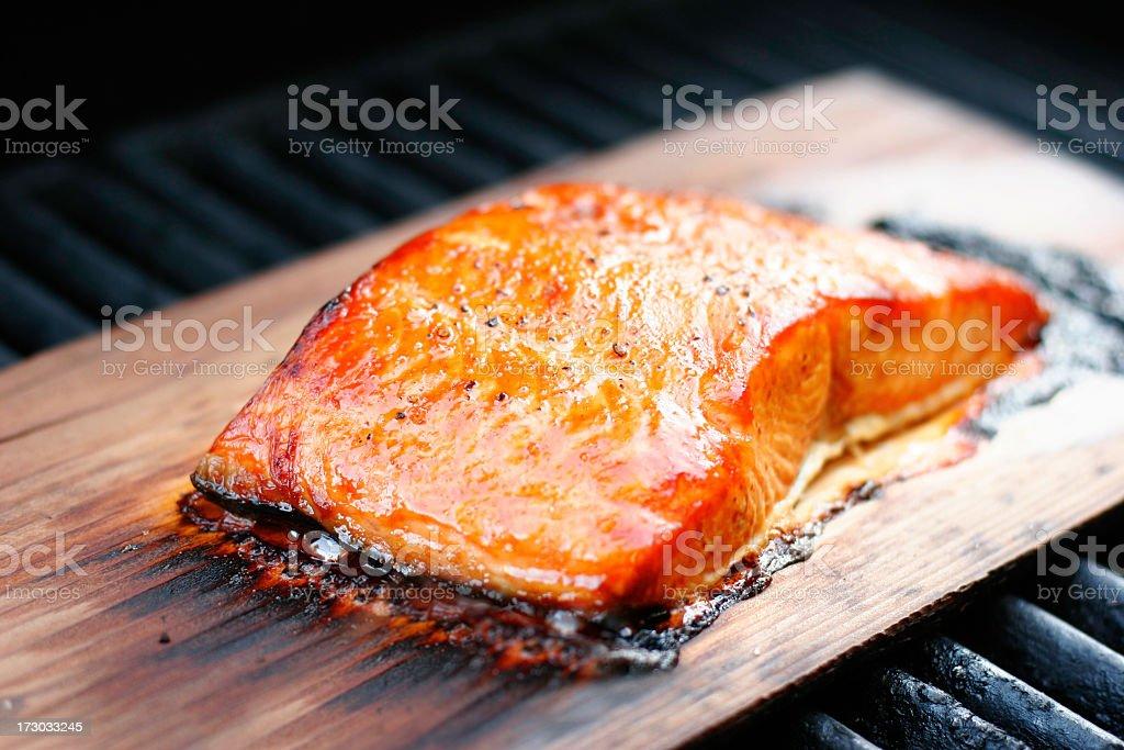Cooked Cedar plank salmon on wood stock photo