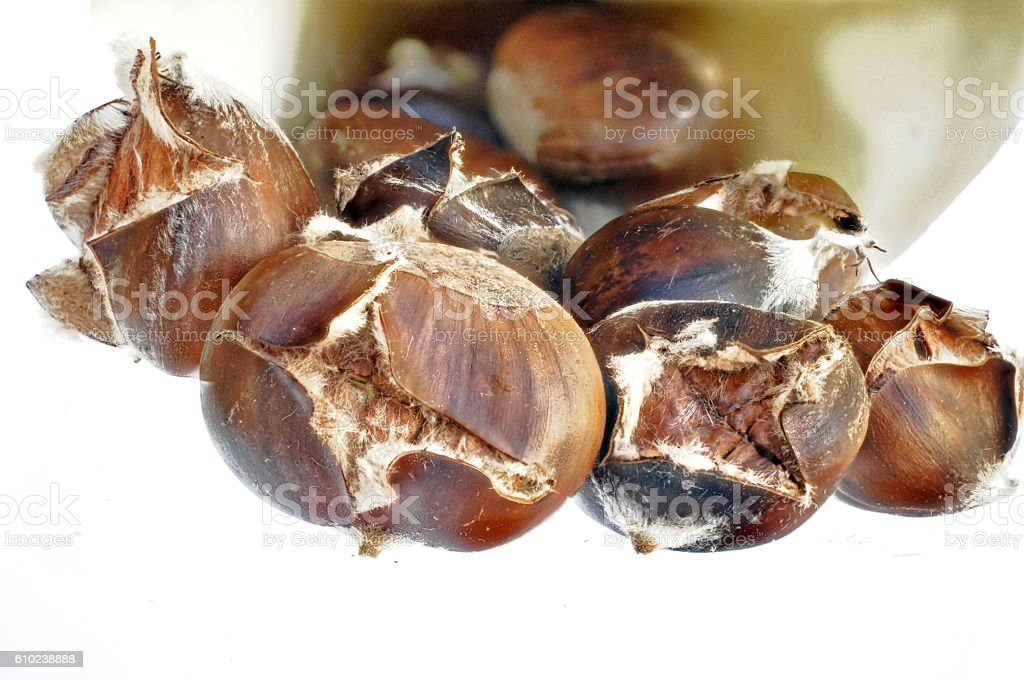 cooked chestnuts with shell for cropping. stock photo
