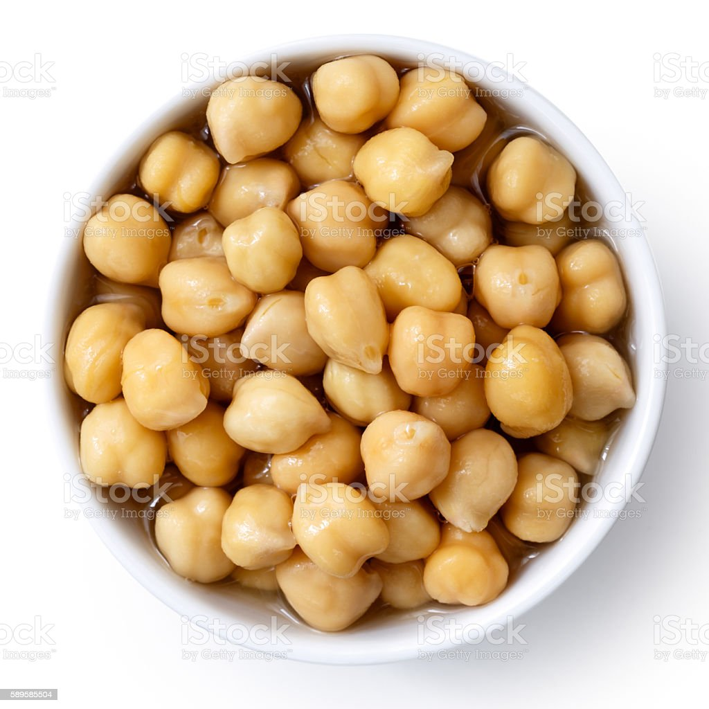 Cooked chickpeas in white bowl isolated on white from above. stock photo