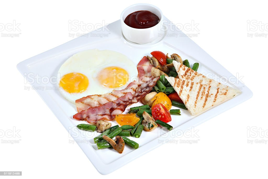 Cooked English breakfast, fried eggs with bacon on square platte stock photo