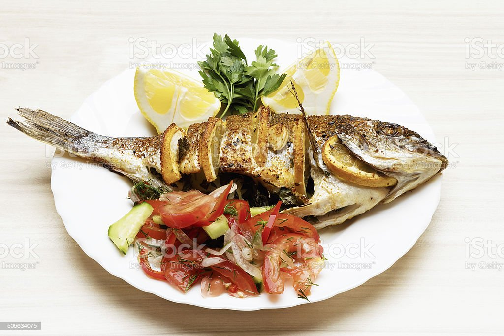 Cooked fish sea bream fish. stock photo