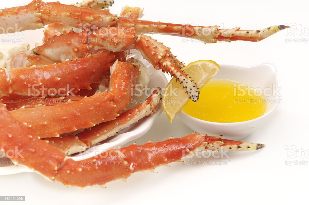 Cooked king crab legs and claws served with butter stock photo