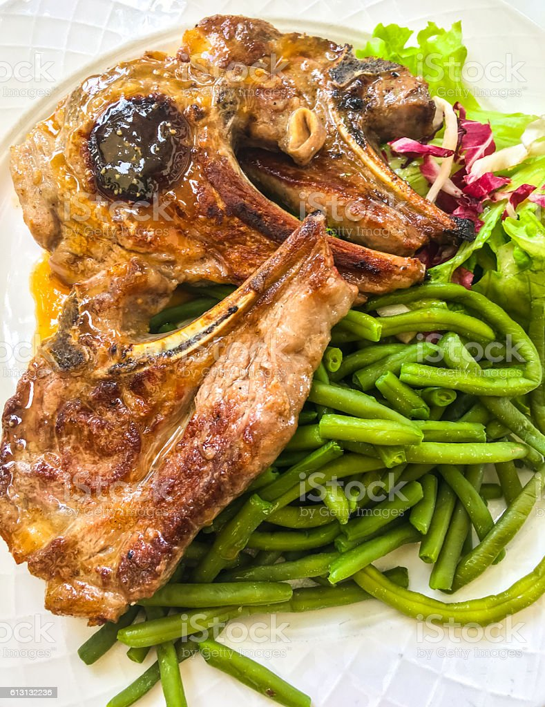 Cooked lamb meat with greens and green beans stock photo