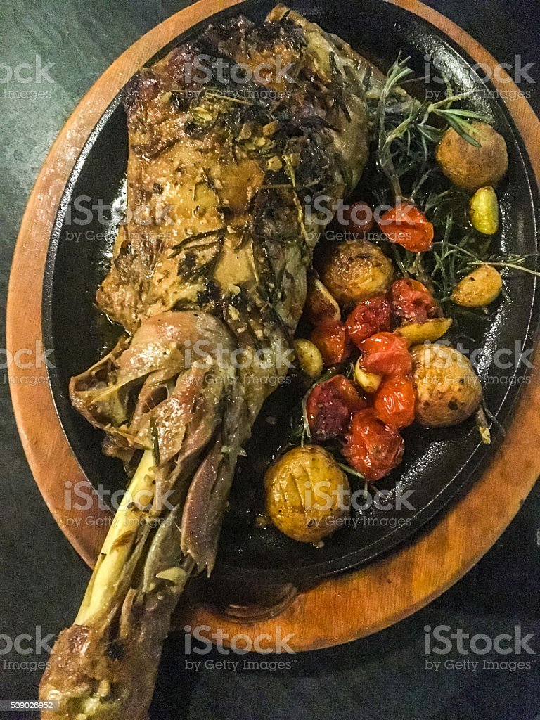 Cooked lamb with vegetables on a plate stock photo