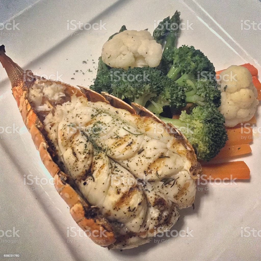 Cooked Lobster with broccoli and cauliflower stock photo