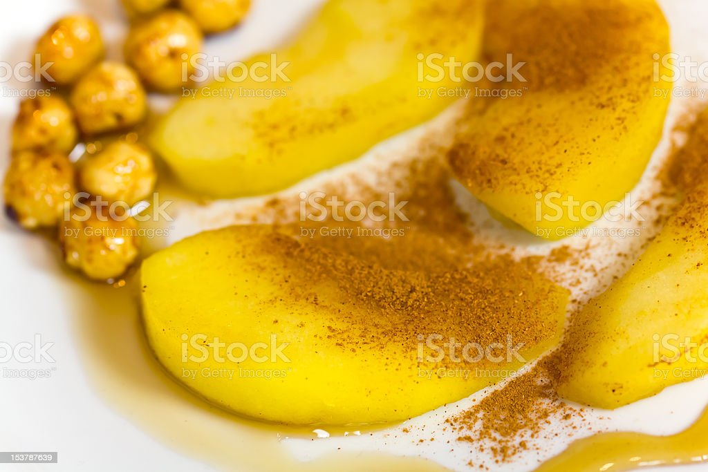 Cooked pears and caramelized hazelnuts royalty-free stock photo