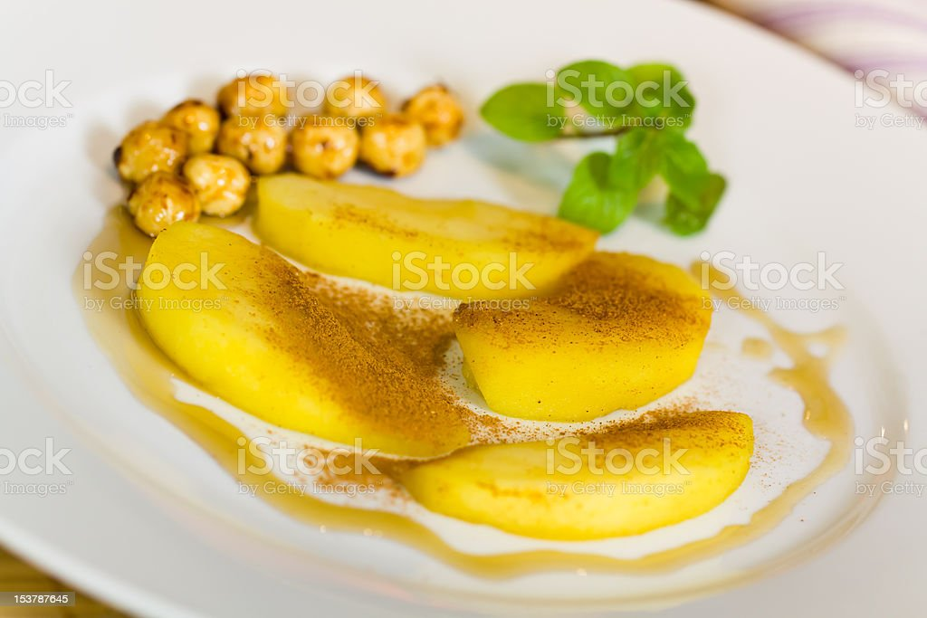 Cooked pears and caramelized hazelnuts stock photo
