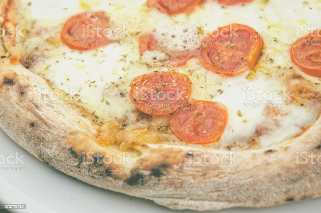 Cooked pizza with organic tomatoes stock photo