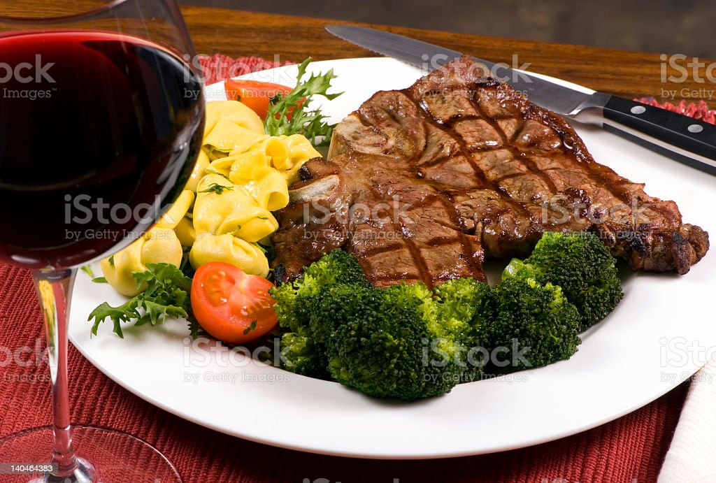 Cooked Porterhouse steak and vegetables royalty-free stock photo