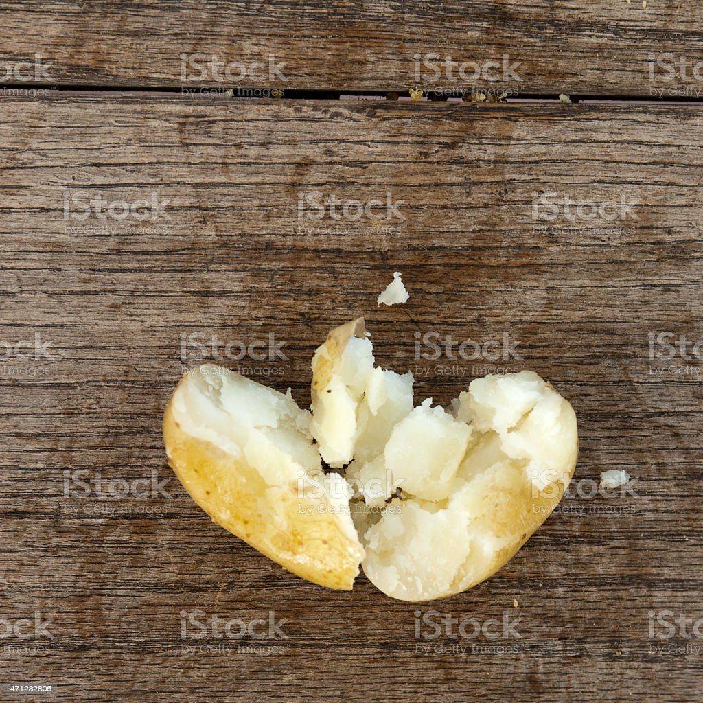 Cooked potato on wood background stock photo