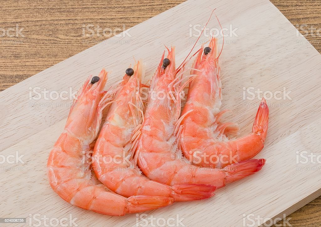 Cooked Prawns or Tiger Shrimps on Cutting Board stock photo