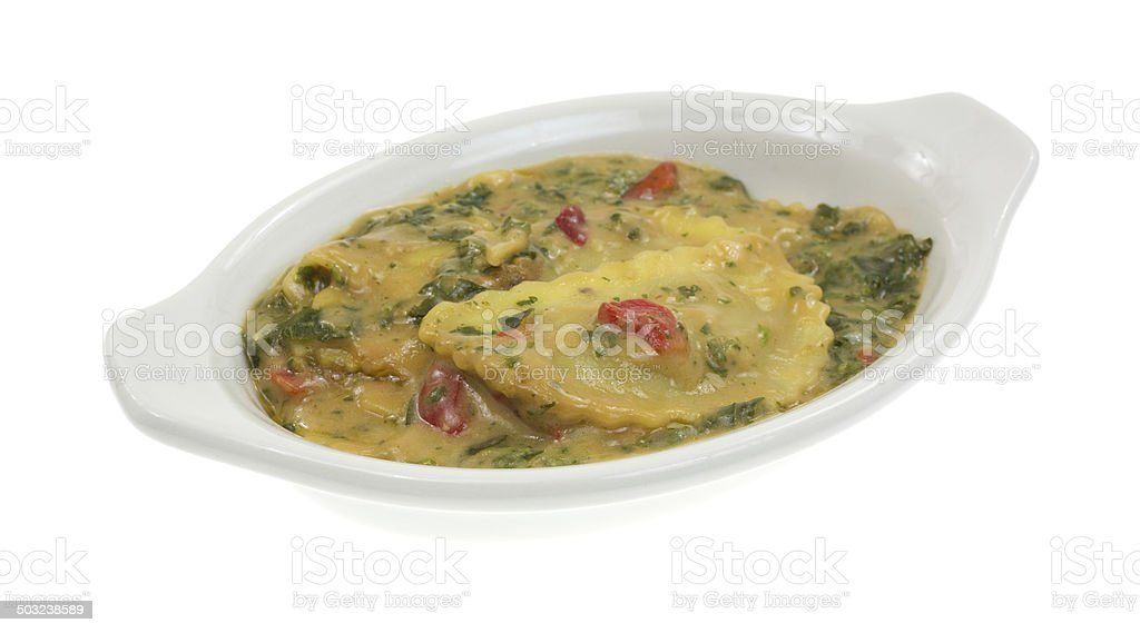 Cooked ravioli in wine sauce with spinach royalty-free stock photo