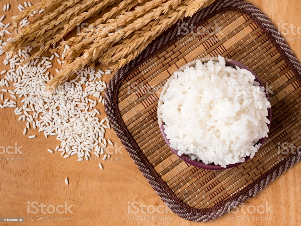 Cooked rice in bowl on  wooden table background. stock photo