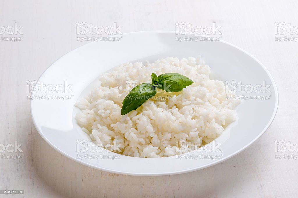 cooked rice with basil stock photo