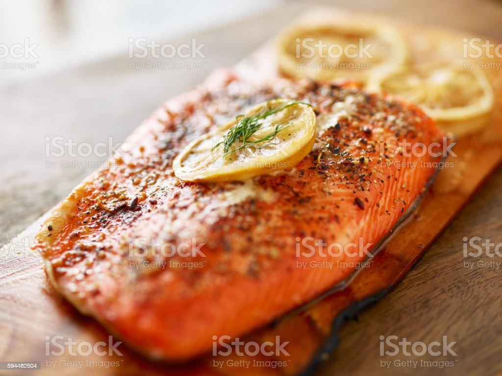 cooked salmon fillet on wooden cedar plank stock photo
