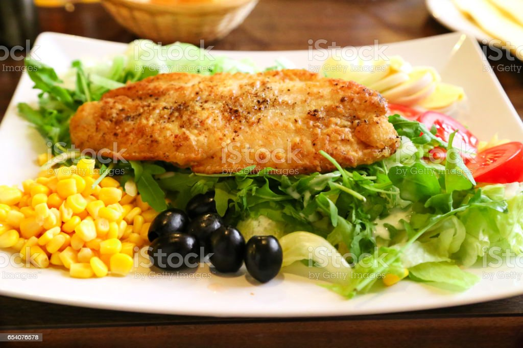 cooked salmon fish with vegetables stock photo