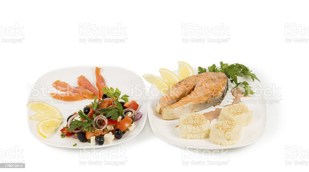 Cooked salmon steak and salad royalty-free stock photo