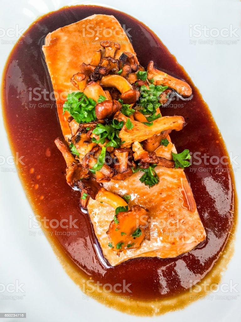Cooked salmon steak in chanterelle sauce, Sweden stock photo