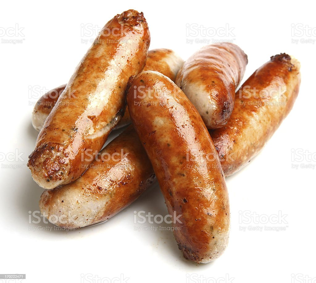 Cooked sausage piled together with a white background stock photo