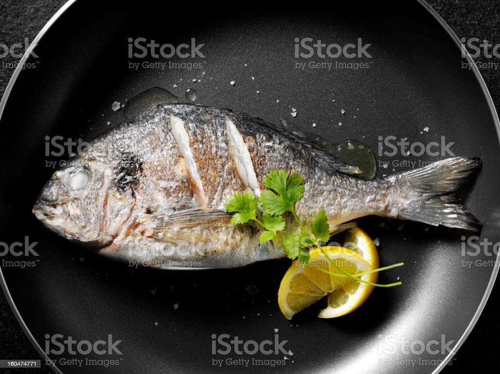 Cooked Sea Bream in a Frying Pan stock photo
