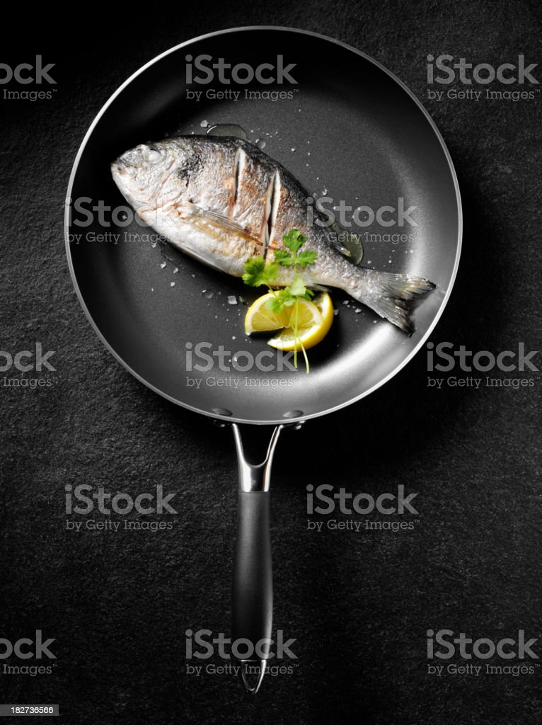 Cooked Sea Bream with Lemon royalty-free stock photo