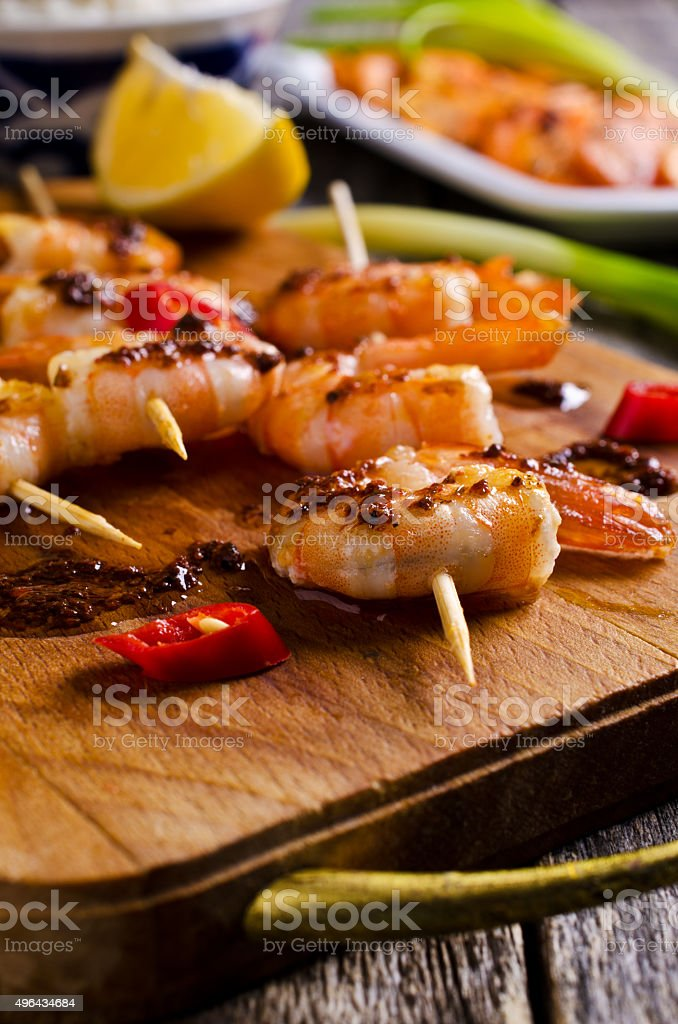 Cooked shrimp on skewers stock photo