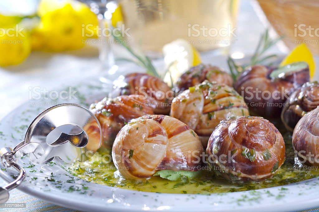 Cooked snails, known as Escargot, with garlic sauce stock photo