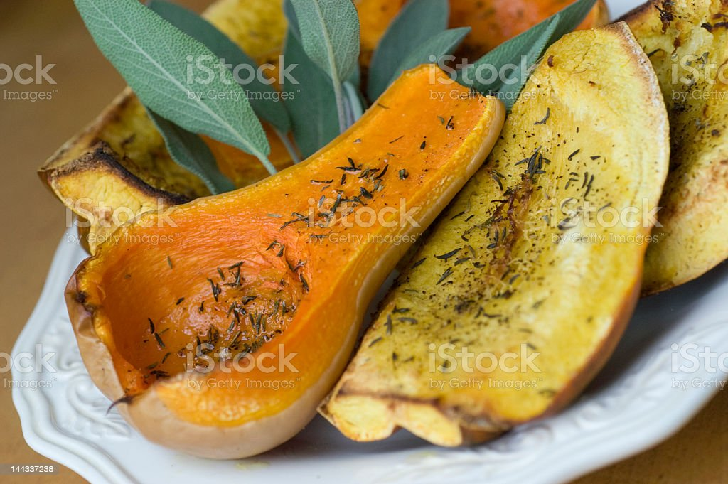 Cooked squash sitting on a plate with parsley royalty-free stock photo